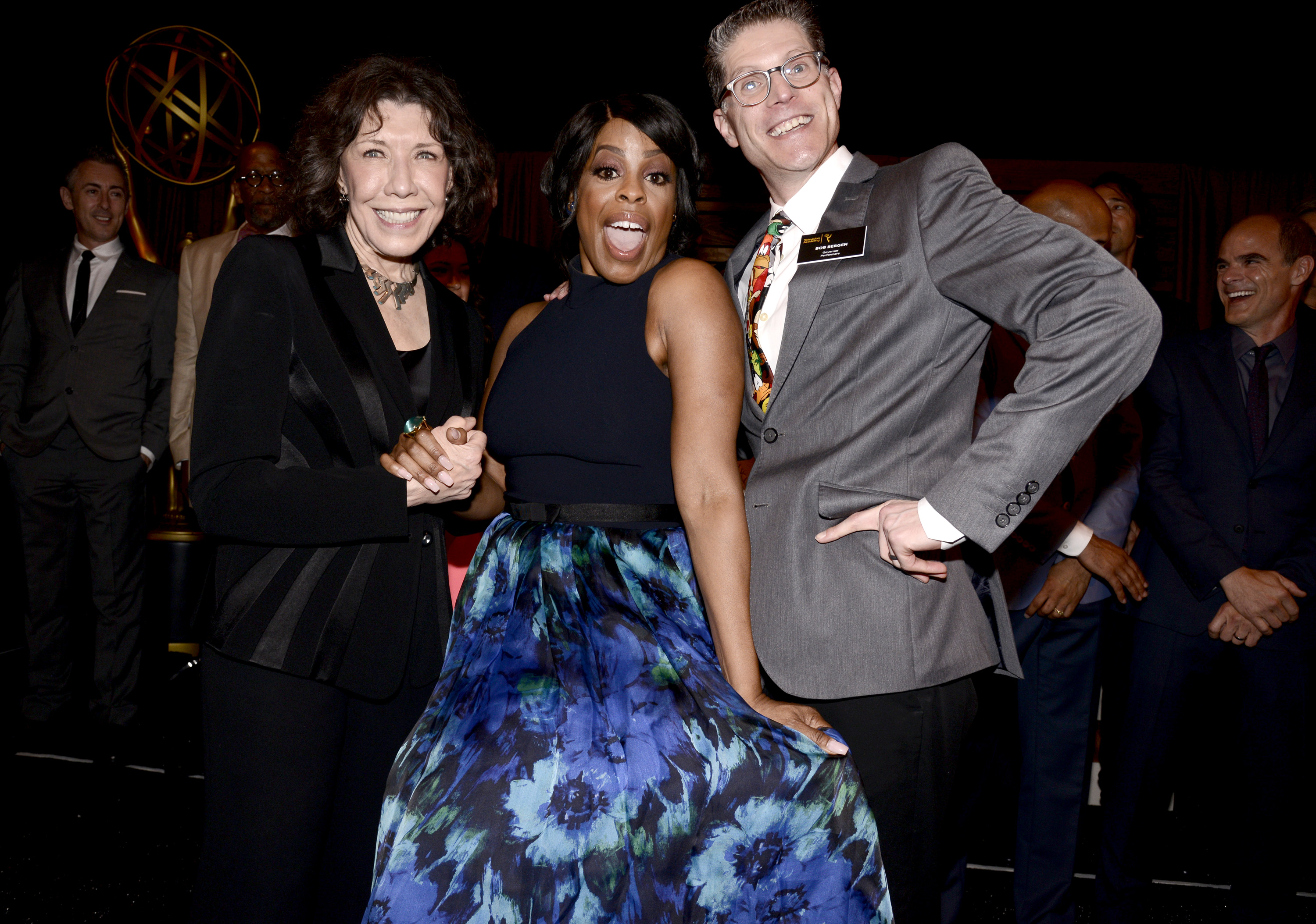 EXCLUSIVE - Lily Tomlin, from left, Niecy Nash, and Academy Governor Bob Bergen, attend the Television Academy's 67th Emmy Awards Performers Nominee Reception at the Pacific Design Center on Saturday, Sept.19, 2015, in West Hollywood, Calif. (Photo by Dan Steinberg/Invision for the Television Academy/AP Images)