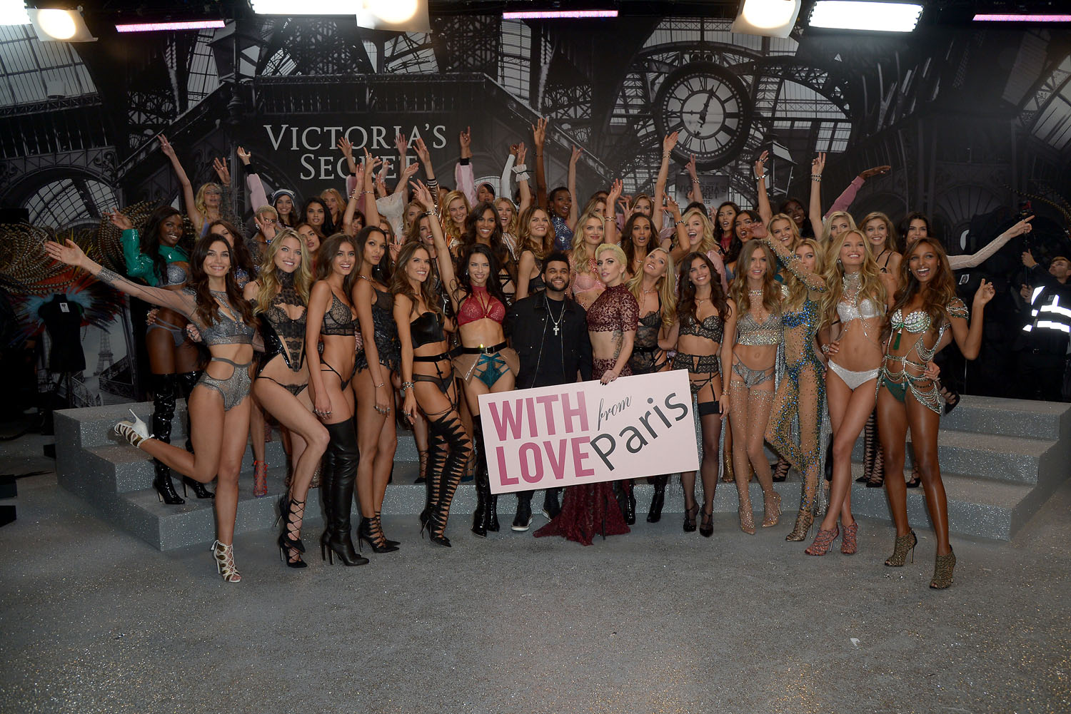 PARIS, FRANCE - NOVEMBER 30: Models pose backstage with Lady Gaga and The Weeknd during the Victoria's Secret Fashion Show on November 30, 2016 in Paris, France. (Photo by Dominique Charriau/Getty Images for Victoria's Secret)