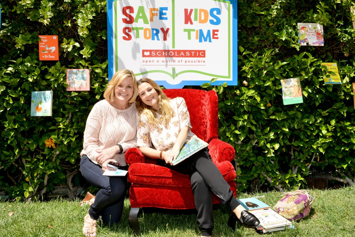 WEST HOLLYWOOD, CA - APRIL 26:  President and CEO of Safe Kids Worldwide Kate Carr (L) and actress Drew Barrymore read to kids during story time at Safe Kids Day presented by Nationwide 2015 on April 26, 2015 in West Hollywood, California.  (Photo by Araya Diaz/Getty Images for Safe Kids Worldwide)